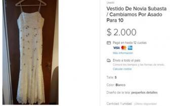Imagen de Se divorció y cambia su vestido de bodas por un asado con amigos