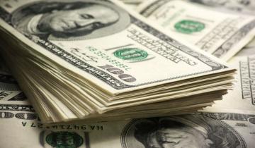 Imagen de El dólar revirtió la suba inicial y cayó a 57,27 pesos