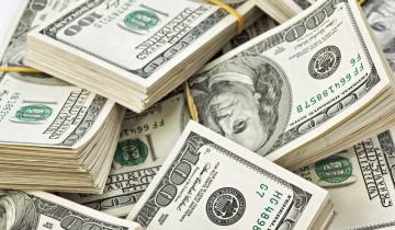 Imagen de El dólar cerró en baja a 63,22 pesos pero acumuló en octubre una suba de $3,40