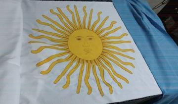 Imagen de Un pueblo de Castelli se une para confeccionar una bandera argentina gigante